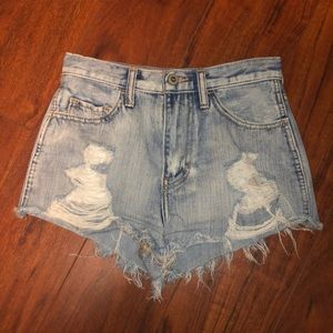 Acid washed, high waisted shorts with lots of rips